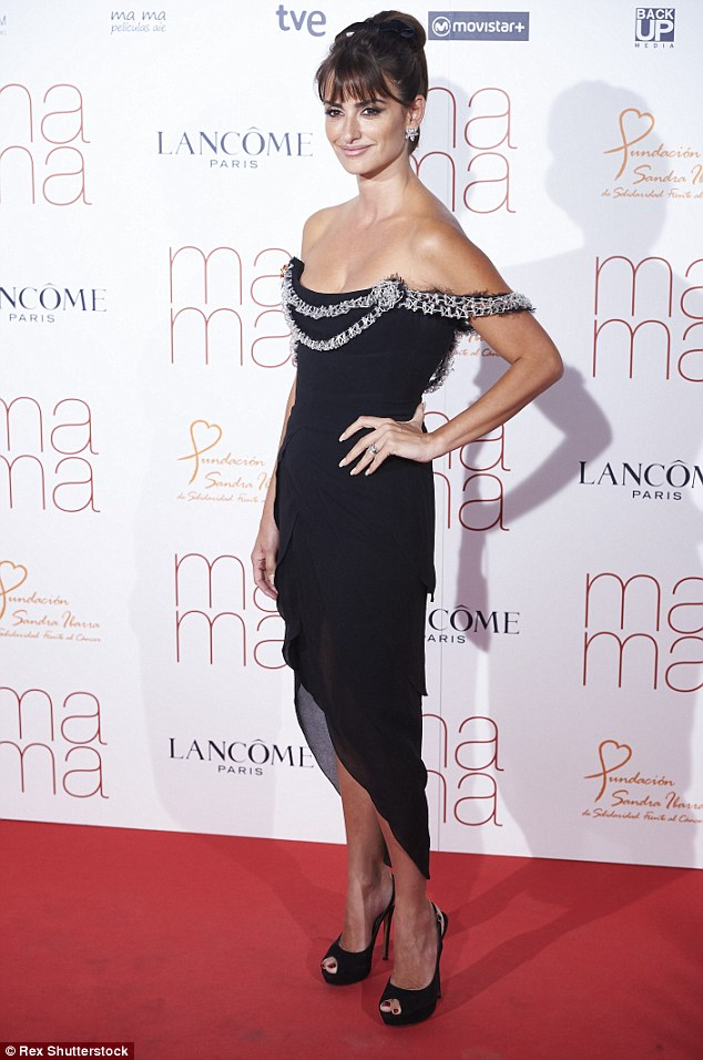 Picture perfect: Turning heads as she walked down the red carpet, the Spanish beauty showed off her perfect figure in a striking off-shoulder dress