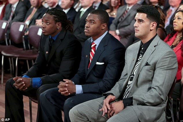 Top spot: Mariota (right) was up against finalist Melvin Gordon (left), running back for the University of Wisconsin, and Amari Cooper (center), a University of Alabama receiver