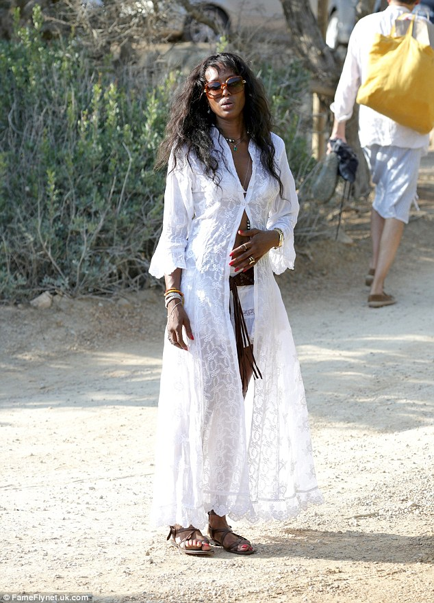 Summer lovin': Naomi Campbell was an ethereal island dream in white as she emerged during a recent holiday in Ibiza