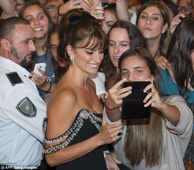 Buzzing crowd: She also happily took selfies with her loyal fans