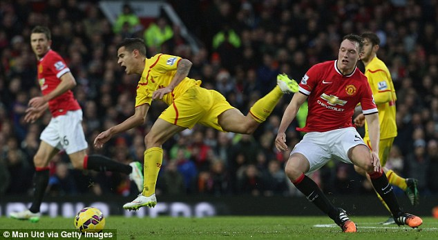Coutinho (left) loses his footing during a confrontation with Manchester Untied defender Phil Jones