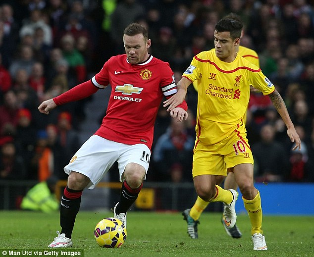 Rooney (left), who put United ahead in the 12th minute, shields the ball from Coutinho
