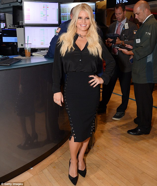 Regrets: Jessica Simpson says her biggest 'money mistake' was her first marriage to fellow pop star Nick Lachey, pictured on Thursday at the New York Stock Exchange