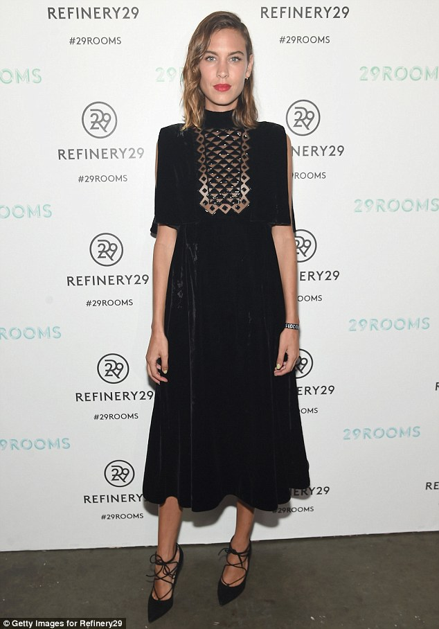 Modest miss: English fashion model Alexa Chung delighted in a black dress with patterned panel in front