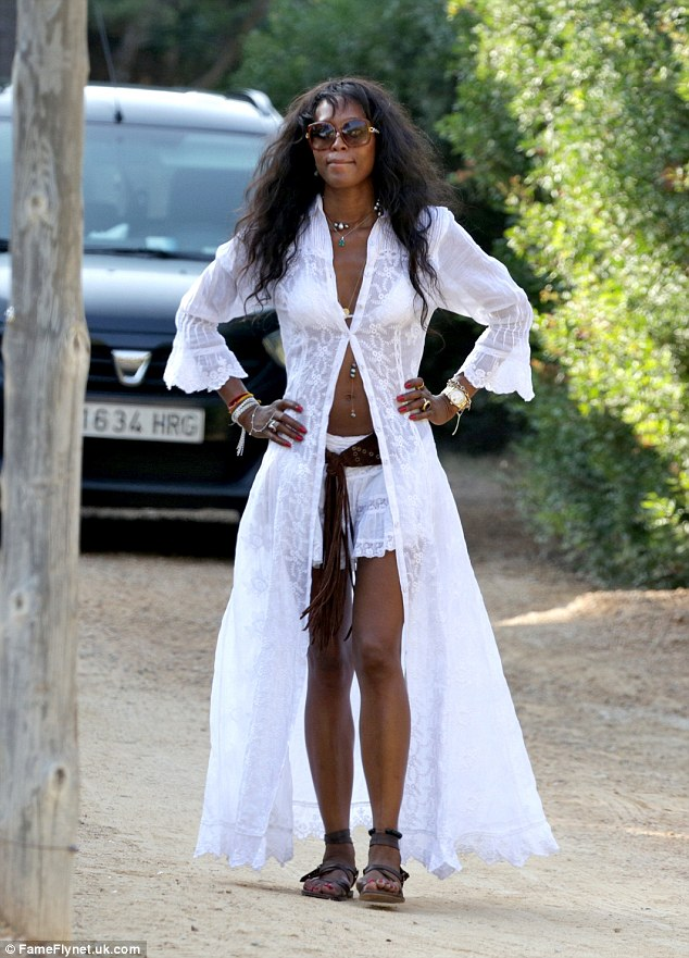 And, pose! The gorgeous star flaunted her long legs and enviably flat stomach in the bikini top and shorts, worn under an open shirt