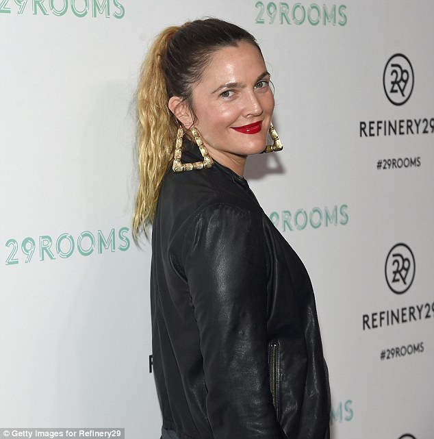 Loopy hoops: Drew wore a pair of elaborate earrings that vied for attention with her red lipstick