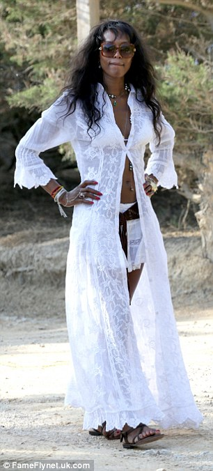 The leggy beauty showed off her impressively-honed physique in a sheer white dress left unbuttoned, showing off her toned tum