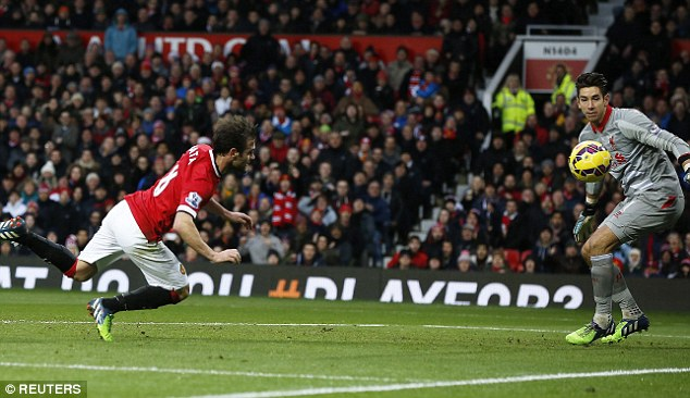 Jones can only watch on as Juan Mata (left) scores United's second at Old Trafford