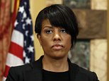 FILE - In this May 1, 2015, file photo, Mayor Stephanie Rawlings-Blake prepares to speak at a media availability at City Hall in Baltimore. Rawlings-Blake said Friday, Sept. 11, 2015, she will not seek re-election nearly five months after the city erupted in rioting following the death of Freddie Gray, who was injured while in police custody. The announcement comes just days after officials said the city would pay Gray's family $6.4 million to settle civil claims over his spinal injury. (AP Photo/Alex Brandon, File)