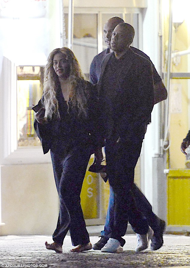 Looking dapper: Jay-Z put on a smart display in a black shirt and suit jacket