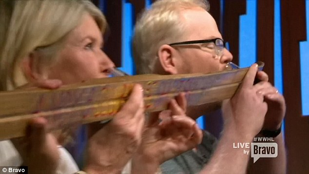 Who needs Keith Floyd? Cook Martha looked like a dab hand at downing booze as she drank from the shotski