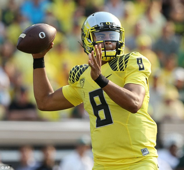 High-scorer: Mariota has the second-highest percentage of possible points (90.92) in Heisman history, second only to Ohio State quarter back Troy Smith who had 91.63 in 2006. Pictured above in Oregon's September 6, 2014 game against Michigan State