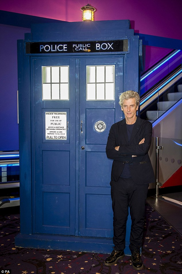 Feeling at home: Peter struck a pose by the TARDIS, the other VIP guest at the premiere screening
