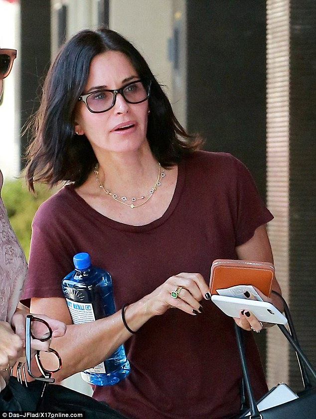 Fresh faced: The Friends star looked remarkably line-free, with a pair of tinted square-framed glasses covering her eyes