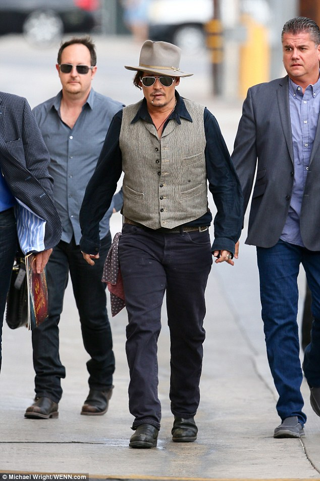 Heated: Johnny Depp was covered up from head-to-toe when he arrived to Jimmy Kimmel Live! studios on Wednesday