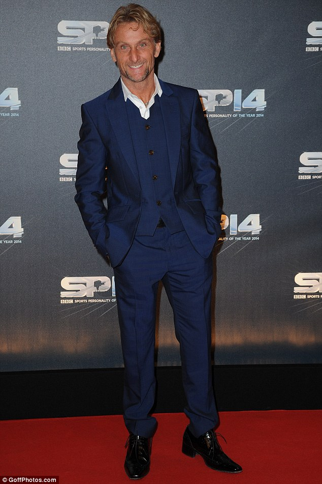 Stepping out in style: The World Superbike champ looked dapper in a blue three-piece suit