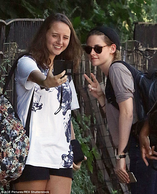 Peace! Stewart - who sweetly posed for a fan selfie - reportedly scored the unlikely role after Emma Stone and Jennifer Lawrence turned down the part