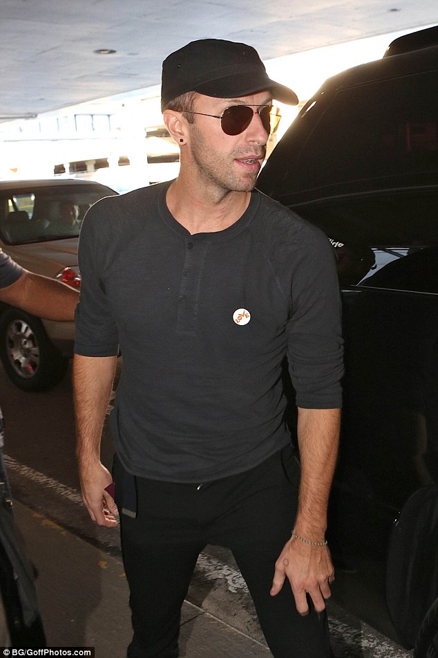 Plain:Wearing a pair of black, skinny jeans with a grey T-shirt, the estranged husband of Gwyneth Paltrow was typically nondescript