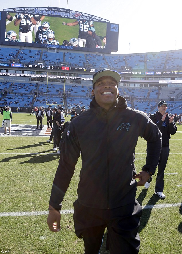 Impressive recovery: Cam Newton made his first appearance in front of fans at Panthers stadium on Sunday, since he was injured in a car crash on Tuesday