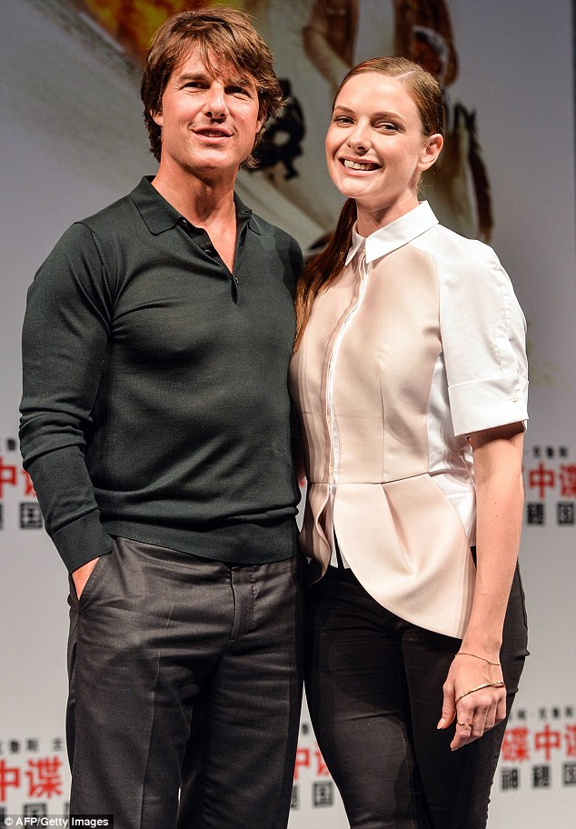 On a career high: Meanwhile, Cruise is still promoting monster hit Mission: Impossible - Rogue Nation with Swedish actress Rebecca Ferguson; here they are seen together in Shanghai on September 6
