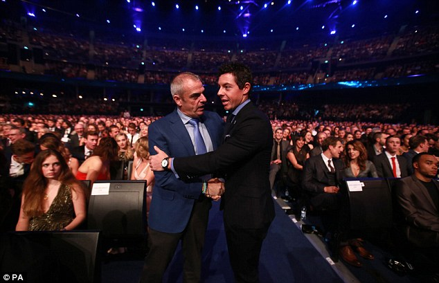 McIlroy (right) greets Paul McGinley as the golfing pair take their seats at the SSE Hydro in Glasgow