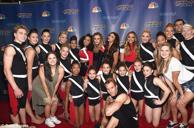 Group shot: The former X Factor starlets were joined by a troupe of energetic dancers, ArcoArmy