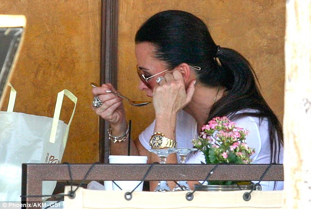 Aren't you hot? Kyle Richards took a sip from her soup while dining al fresco at Il Pastaio restaurant in Beverly Hills on Wednesday