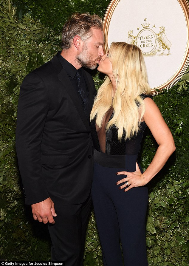 Time for a kiss: The blonde bombshell got an appreciative kiss from her attentive husband, Eric Johnson, at the soiree held at Tavern at the Green