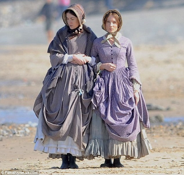 In good company: Joanne was joined on set by a female co-star and the two linked arms as the cameras rolled