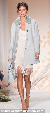 Feminine: The 29-year-old's stunning collection boasted a series of textures, ranging from delicate lace to layered mesh, though her colour palette was comprised largely of delicate pastel tones