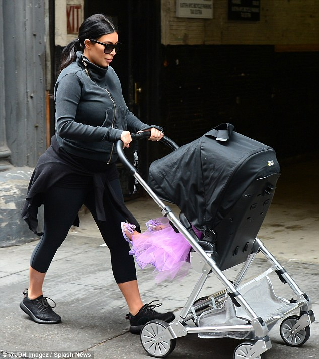 Only the best for you! Kim Kardashian gave her daughter North West, two, the full royal treatment as they stepped out for a stroll in New York City on Thursday