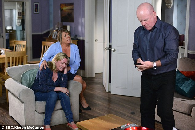 Is it all over for the Beale family? As Jane sobs, Phil's wife Sharon (Letitia Dean) appears to plead with him