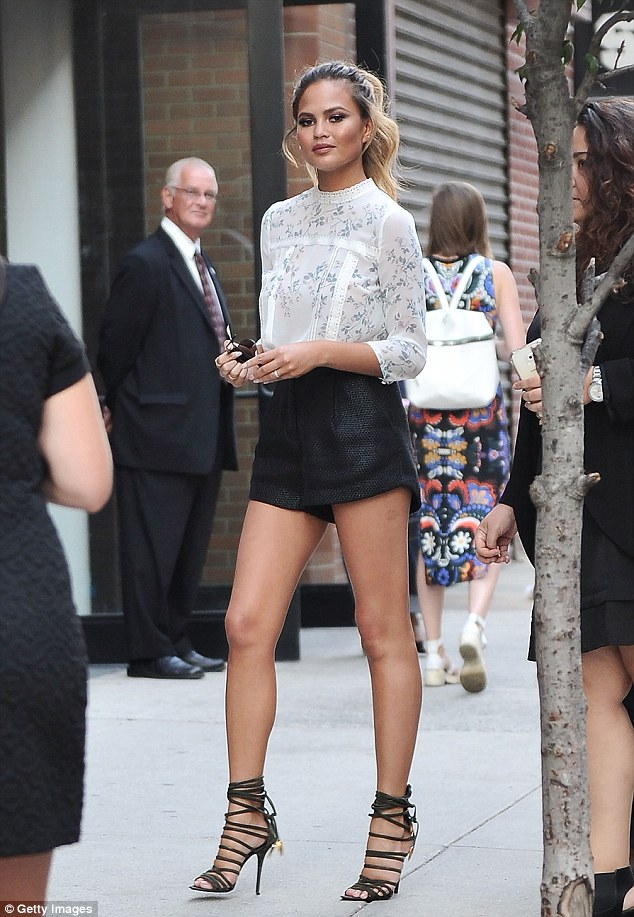 Leggy display: Chrissy Teigen showcased her enviable pins when she attended Lauren Conrad's Spring 2016 fashion show in New York City on Wednesday