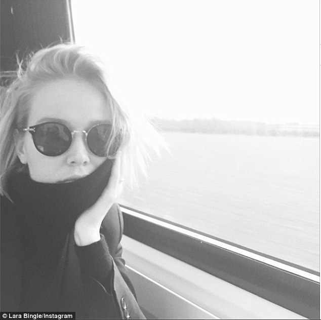Artistic selfie: The 27-year-old posted her first new photo in a number of weeks on Sunday but the black and white image had her eyes and rumoured baby bump all covered up