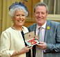 Actress Lynda Bellingham, with her husband Michael, holding her OBE (Officer of the Order of the British Empire).  Lynda Bellingham died in her husband?s arms after a battle with cancer.    PRESS ASSOCIATION Photo. Issue date: Monday October 20, 2014. See PA story DEATH Bellingham. Photo credit should read: John Stillwell/PA Wire