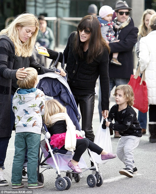 Play time: Selma and her son appeared to meet up with some pals at the market