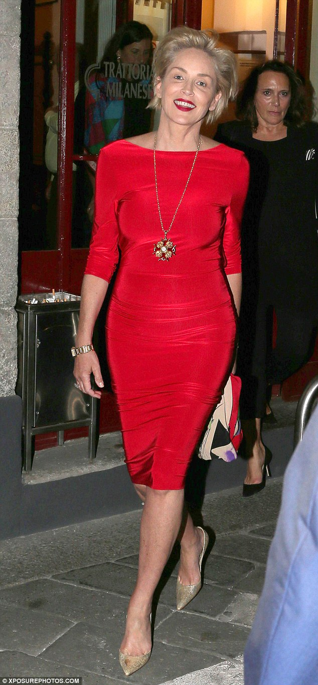 Lady in red: Sharon Stone looked typically stunning in a sultry red gown as she dined at Milans' Trattoria Milanese restaurant with friends on Wednesday evening