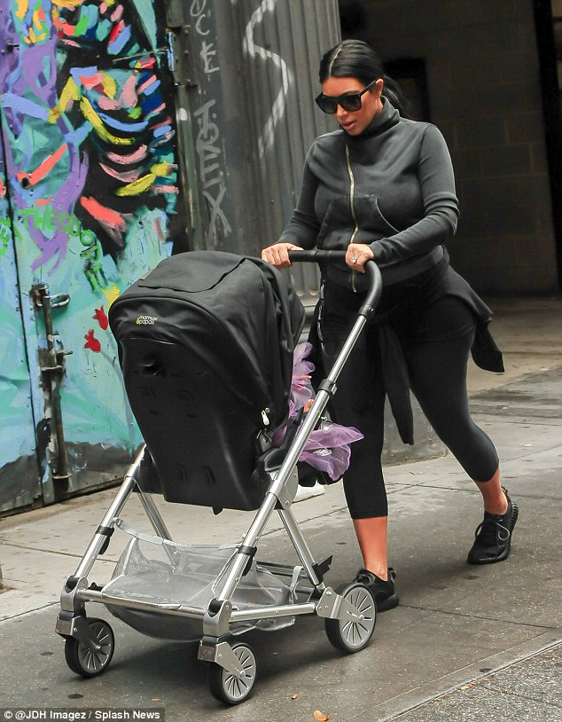 Checking in: Kim looked in on North inside her carriage