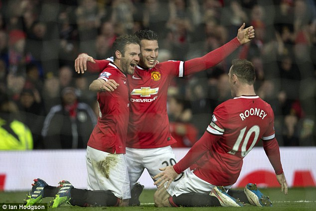 Goalscorers (L-R) Juan Mata, Robin van Persie and Rooney celebrate victory as United move up to third