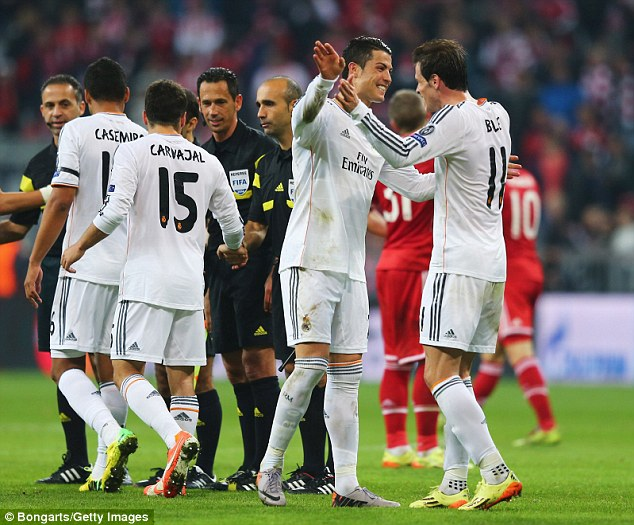 Gareth Bale (right) and Ronaldo celebrate after the Champions League semi-final victory over Bayern Munich