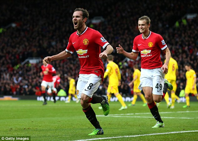 Mata celebrates after scoring United's second goal against arch rivals Liverpool at Old Trafford