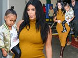 NEW YORK, NY - SEPTEMBER 09:  Television personality Kim Kardashian West (L) and North West leave their Soho apartment on September 9, 2015 in New York City.  (Photo by Ray Tamarra/GC Images)