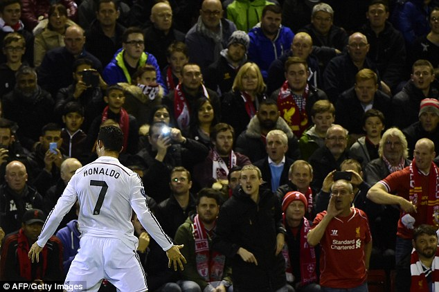 Ronaldo celebrates in front of the Liverpool fans at Anfield after scoring the winner for Real