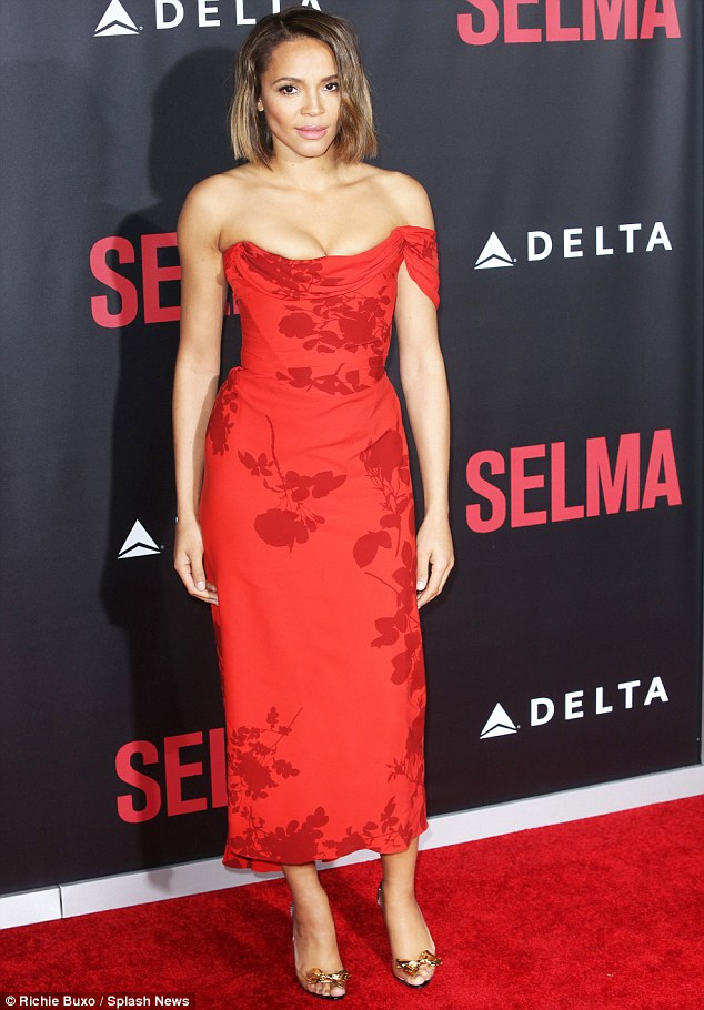 Red hot! Carmen Ejogo, 40, who plays King's wife and partner in activism, Coretta Scott King, was striking in a clinging red gown featuring an elegant floral print