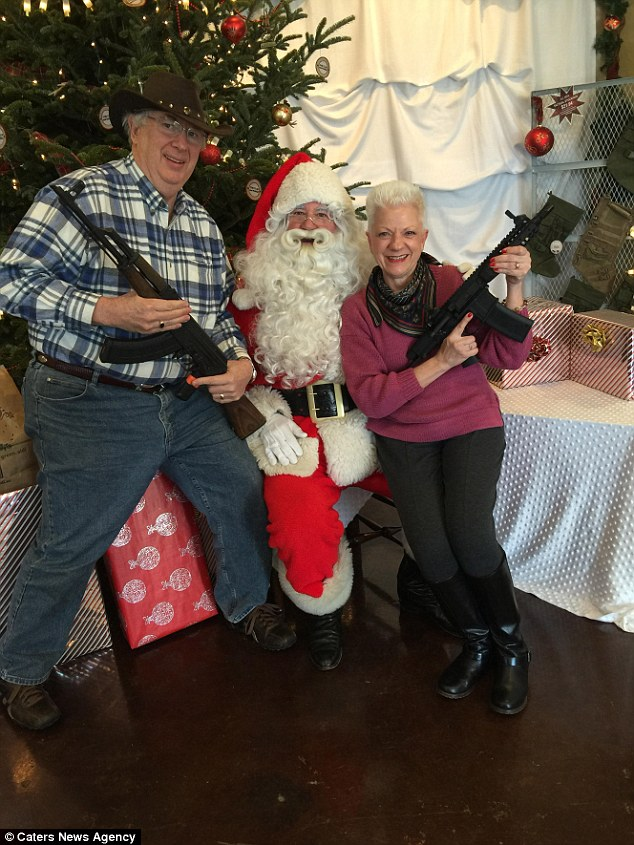 Couple time: People of all ages came to sit on Santa's lap and talk about Christmas and rifles