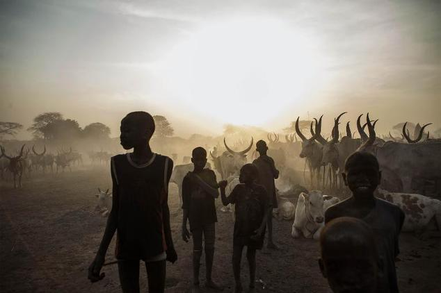 South Sudanese children from the Dinka ethnic group pose at cattle camp in the town of Yirol, in central South Sudan on February 12, 2014