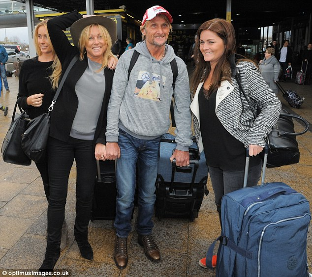 The king of the jungle returns home: After winning I'm A Celebrity... Get Me Out Of Here! in Australia, Carl 'Foggy' Fogarty and his wife Michaela were seen touching down at Manchester Airport with their daughters Danielle, left, and Claudia, right, on Wednesday