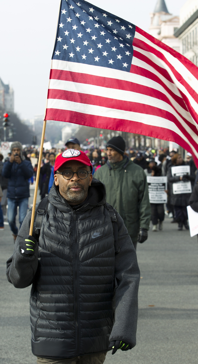 Film director Spike Lee, and others, march on Pennsylvania Avenue toward Capitol Hill in Washington, Saturday, Dec. 13, 2104, during the rally Justice for Al...