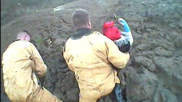 Two teenage girls being rescued from think mud on the Isle of Sheppey in Kent (RNLI)