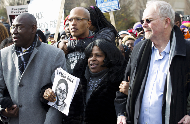 Samaria Rice center, the mother of Tamir Rice, the 12-year old boy who was fatally shot by police officer in Cleveland, and others, march in Pennsylvania Ave...